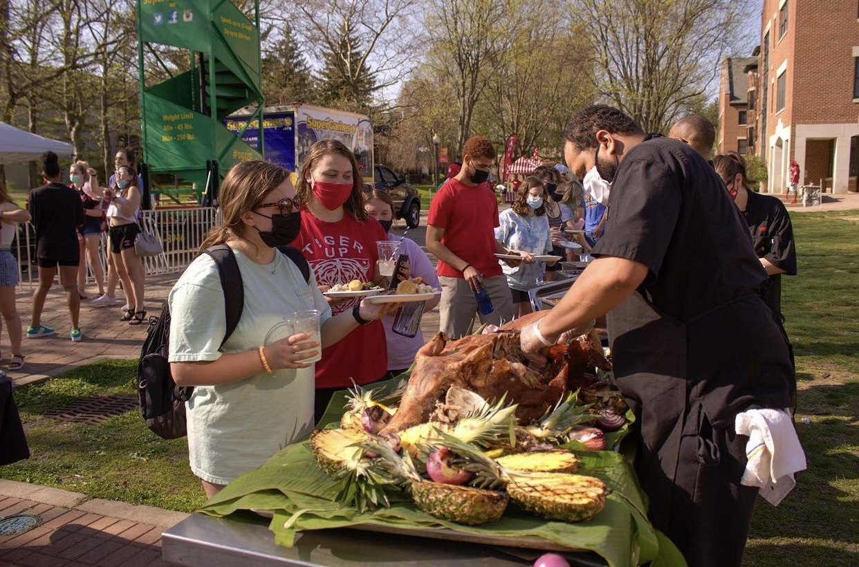 Students gather round for servings of Hawaiian ham at the cook-out